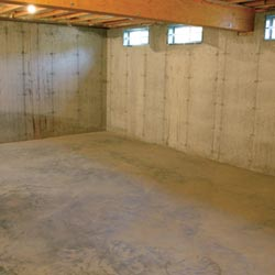A cleaned out basement shown before remodeling has begun