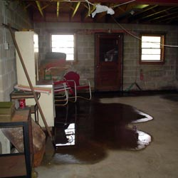 A flooded basement showing groundwater intrusion in Amherst