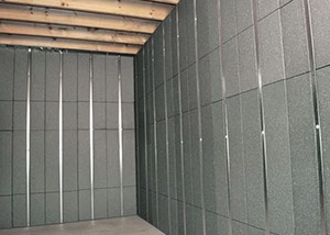 SilverGlo™ insulation and metal studs making up our Basement to Beautiful™ panels.