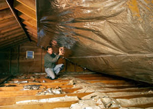 A radiant barrier installed in a Granby attic