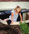 A child crawling out of an egress entryway window system in